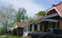 row of brick homes where materials, heights, and proportions are pleasantly similar