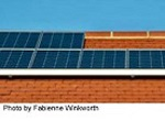solar array atop large brick building