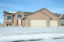 single-family home with front-facing garage, common in sprawl subdivisions