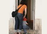 mother and child entering doorway