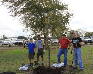 volunteers pause to enjoy their tree planting project