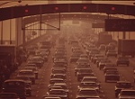 vintage photo showing traffic jam and air pollution