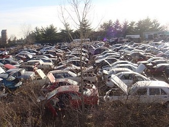 auto salvage yard full of vehicles