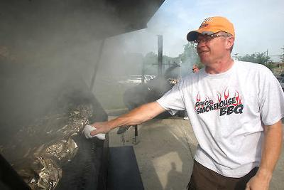 Greg Morris works on his booth smoking various meats at the 2010 BBQ at the Quarry. Times Mail Photo/ Garet Cobb 2010