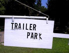 unattractive sign at entrance to manufactured housing park