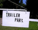 poorly lettered trailer park sign