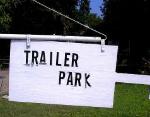 poorly lettered trailer park sign