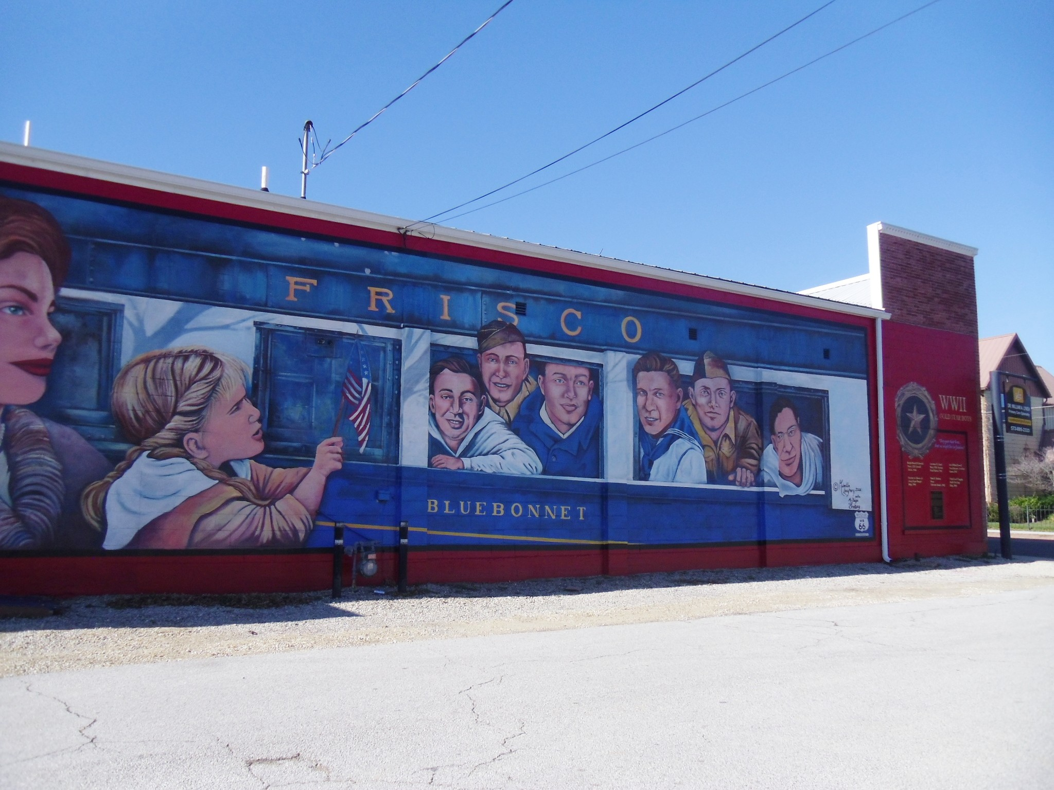 mural of little girl seeing soldiers return from war by train