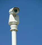 surveillance camera but neighborhood watch is better