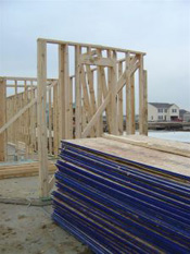new home being framed in subdivision