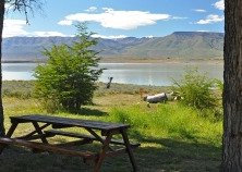 clean picnic table after park clean up, with lake and mountains in backgound