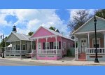 appropriate pink infill housing in row of beach houses