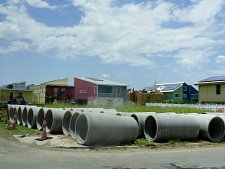 drainage pipes on ground in front of Make It Right Foundation housing in Lower 9th Ward in New Orleans