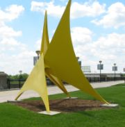 yellow abstract sculpture as example of art in public places