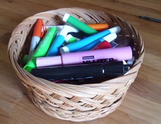 colored markers in a basket
