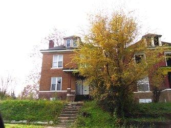 adjacent houses each with broken windows