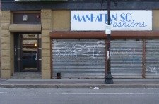 metal doors over business in area of concentrated poverty