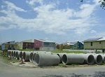 large culverts awaiting installation in New Orleans neighborhood impacted by Katrina