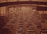 vintage photo of cars on bridge causing air pollution