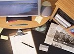 desk with papers and clipboard