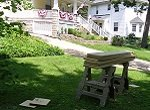 sawhorses and lumber in front lawn