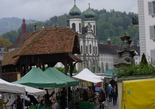 market, great buildings, and mountain backdrop in Luzern