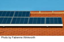solar panel array on top of shingle roof