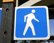pedestrian symbol on blue sign