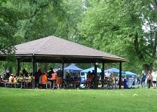 park shelter full of people participating in community event