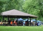group in a picnic shelter serving as headquarters for community project