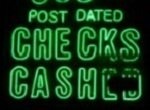 check cashing sign in poor repair