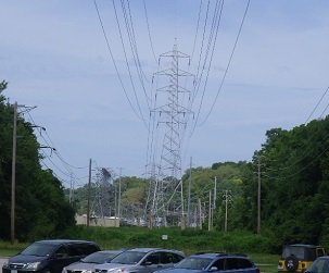 transmission lines streaming across a county park