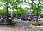 attractive paver plaza and seating in a business district