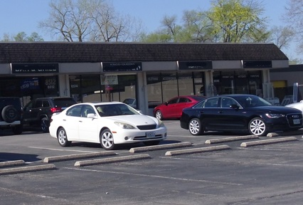 highway oriented strip center with parking in front of retail establishments