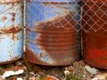rusty drums holding toxic waste