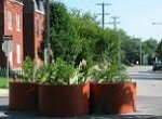 large circular planters in middle of street causing cars to slow down
