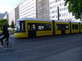yellow tram, bicyclist, and attractive pedestrian environment in Berlin