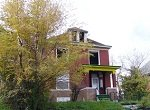 vacant two-story house with windows missing