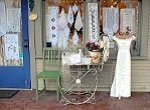 storefront and display dress on sidewalk