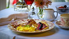 American style big breakfast on white tablecloth